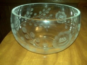 A etched glass bowl with a mixture of sandblasting and engraving.