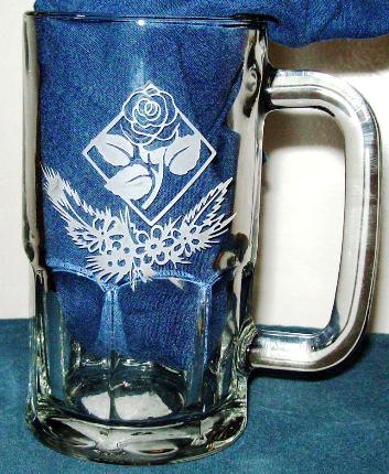 Rose etched in a glass beer mug.