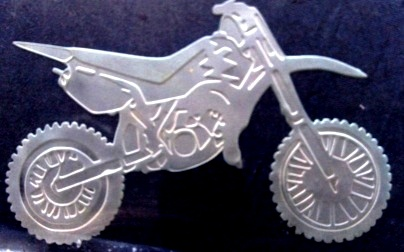 A picture of a dirtbike etched into thick glass.