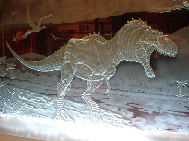 A dinosaur etched by sandcarver Kyle Hunter Goodwin.