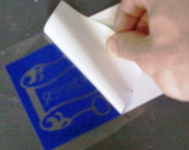Getting the stencil ready for transferring.  Removing the backing paper.