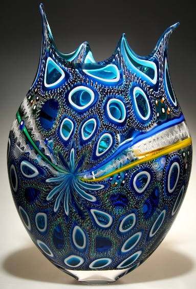 A blue murrine cane blown glass art with elegant designs.