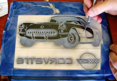 Multi-stage sandcarving a Corvette into plate glass.