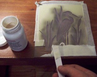 Adding cream to a sandblast etching.