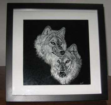 Engraved glass frame of wolves.