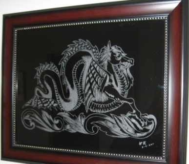 Engraving of a dragon by William K. on a framed glass art.