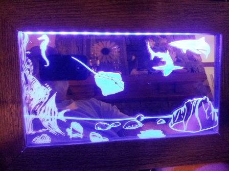 LED mirror etching depicting ocean life.