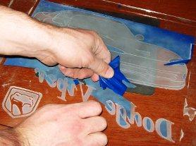 Using a vinyl cut stencil for sandblasting.