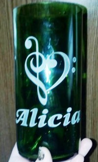 A heart clef and name personalized by etching into cut wine bottle.