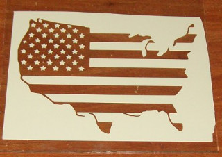 USA stencil placed on glass.