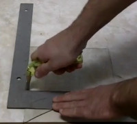 Cutting glass with a cutter wheel.