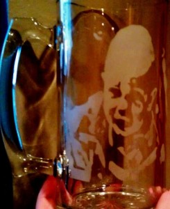 A baby picture etched in a stein.