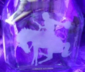 cowboy and horse etched on a jar