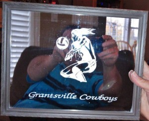 Etched mirror frame for volleyball team.