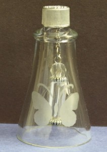 The top of the glass bottle was etched by sandblasting.