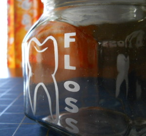 Dental jars etched with a tooth outline design.