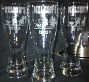 Pilsner glass etched with cowboy stencils.