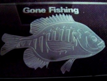 Sandcarving fish in 2 stages on flat glass.