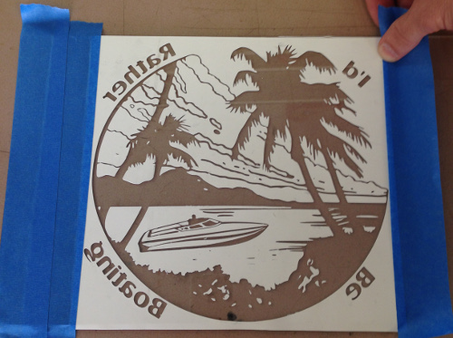 Design your stencil with software and cut it out.