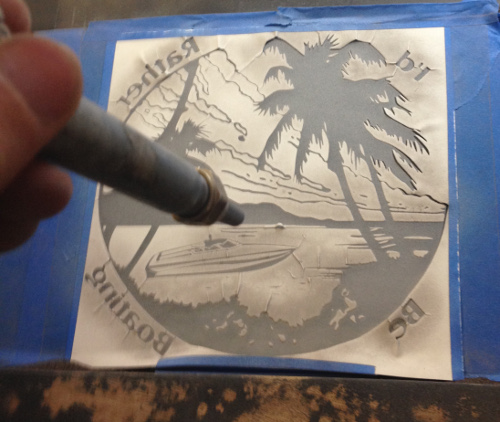 Etch tropical designs on glass with the sandblaster.