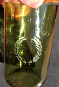 A completed etched glass bottle with Armour etch and Over n over stencils