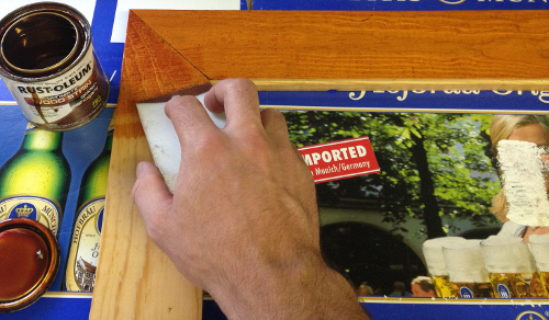 Stain the wood frame and wait for it to dry.