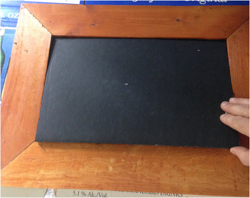 Adding black posterboard to etched glass backing
