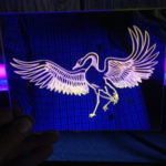 blacklighted etching on glass mirror