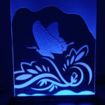 butterfly sandcarving on glass stand.