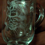 Rotary engraved cat on glass mug.