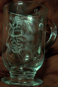 Hand stylus engraved cat on glass mug.
