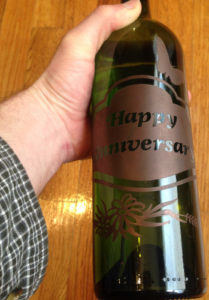 A colored and etched anniversary bottle