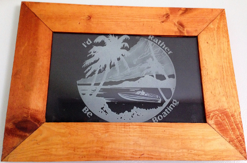 Custom frame etched glass of a boat and beach.