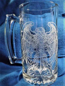 A mug etched with a Dremel rotary tool of an eagle.