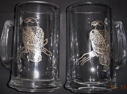 Gold colored etchings on glass mugs.