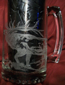 An elk rotary engraved on a beer mug by Diane Lee.
