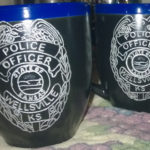 Engraved cermaic cop mugs.
