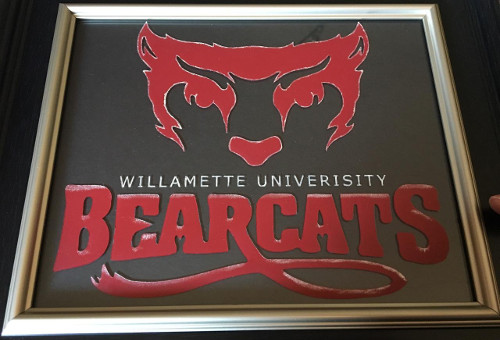 Etched and painted university logo of Willamette University.