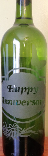 An etched wine bottle gift for an anniversary.