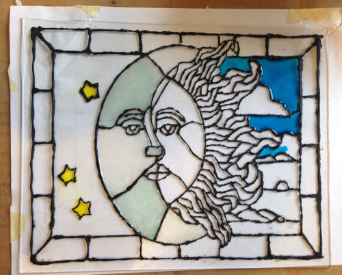 faux stained glass paint being applied in stages.