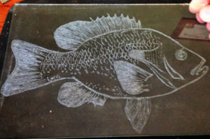 Finished fish hand engraving