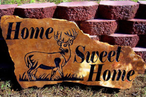 Landscape rock sandblasted with deer and sweet home.