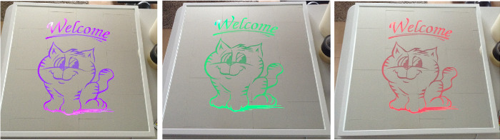 LED mirror etching of welcome sign in multi-colors.
