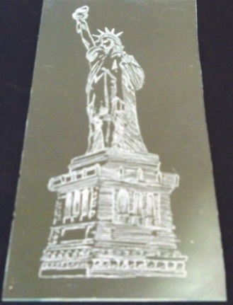 Rotary engraving of the statue of liberty.