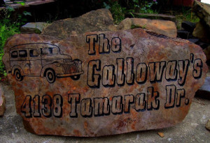 A personalized landscape rock sandblasted with address and name.