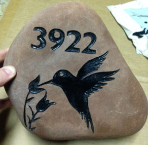 sandblast stone sign with address, flowers and hummingbird.