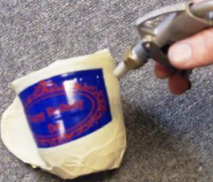 Sandblasting on a mug with unique nozzle.