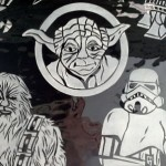 A closer view of the middle portion of the Star Wars glass with Yoda Luke Skywalker and Chewbacca.