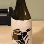 Example pattern cut out of stencil material and placed on bottle.