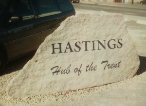 Town names stone sign blasted